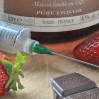 chocolate dipped strawberries with orange flavoured liqueur