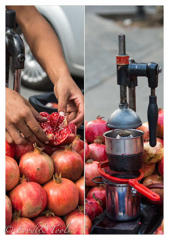 Manually juicing pomegranates for a stall in Istanbu