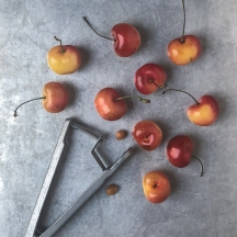 cherries and cherry pitter